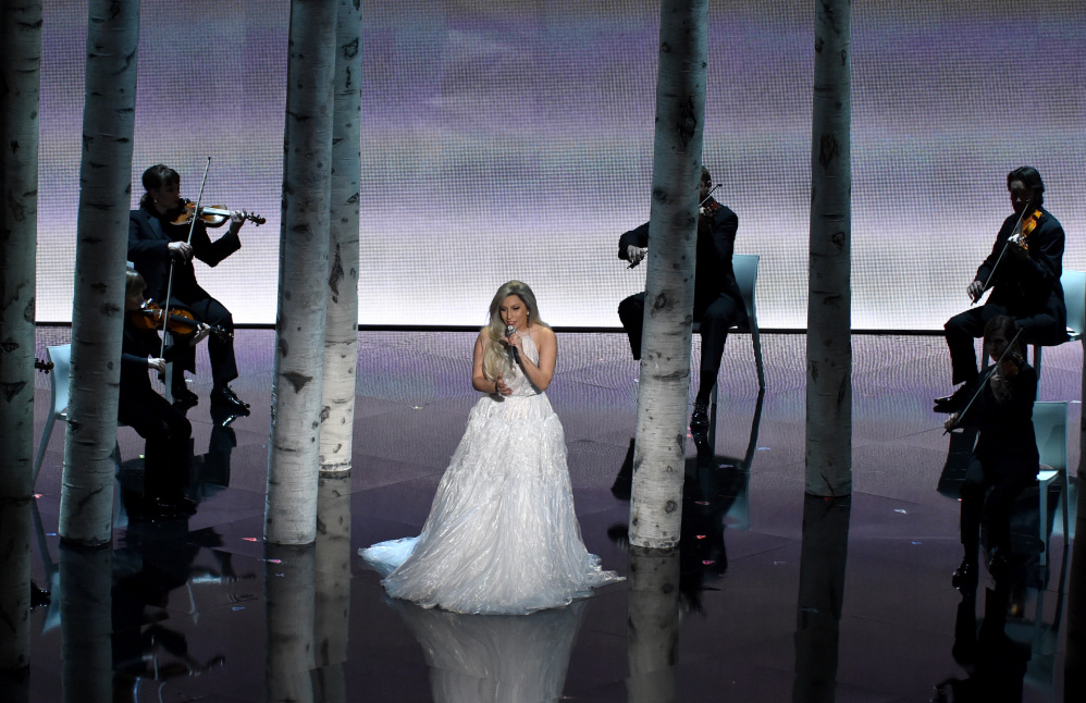 """Lady Gaga performs a medley from the """"Sound of Music"""" at the Oscars on Sunday in tribute to the movie that won best picture 50 years earlier."""