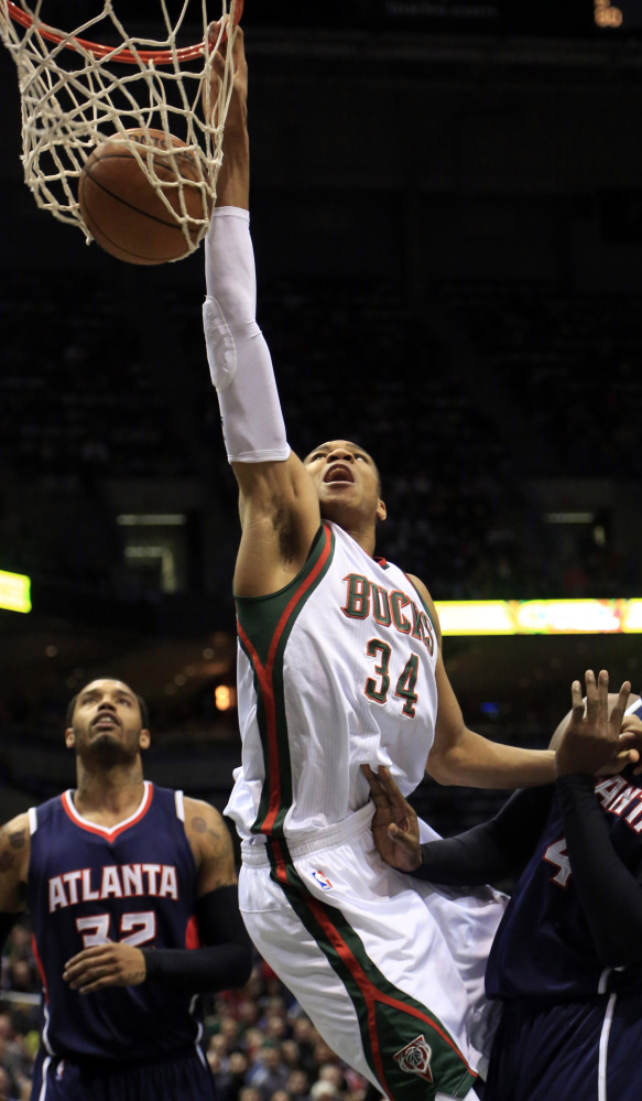 Milwaukee forward Giannis Antetokounmpo dunks during the first half of the Bucks' 97-86 loss to Atlanta on Sunday.
