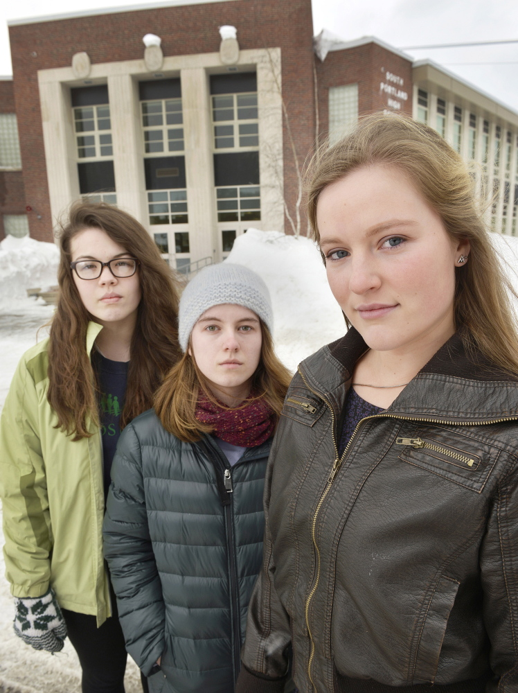 South Portland senior class president Lily SanGiovanni, right, and supporters Morrigan Turner, left, and Gaby Ferrell say some students have felt uncomfortable or pressured by teachers to recite the Pledge of Allegiance at school, so SanGiovanni let students know they could choose not to say it.