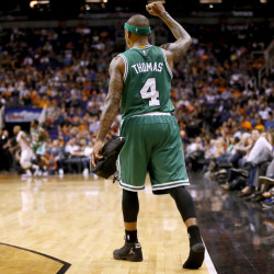 The Celtics' Isaiah Thomas pumps his fist in the second half of Monday night's game in Phoenix. The Celtics won, 115-110. Thomas scored 21 points in his return to Phoenix, four days after the Suns traded him to Boston.