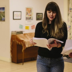 "Kacy Woodworth looks over her lines before rehearsing her part in ""The Maine Dish: A Feast of Plays About Food,"" which will be performed March 5-8 at the Portland Ballet Studio Theater."