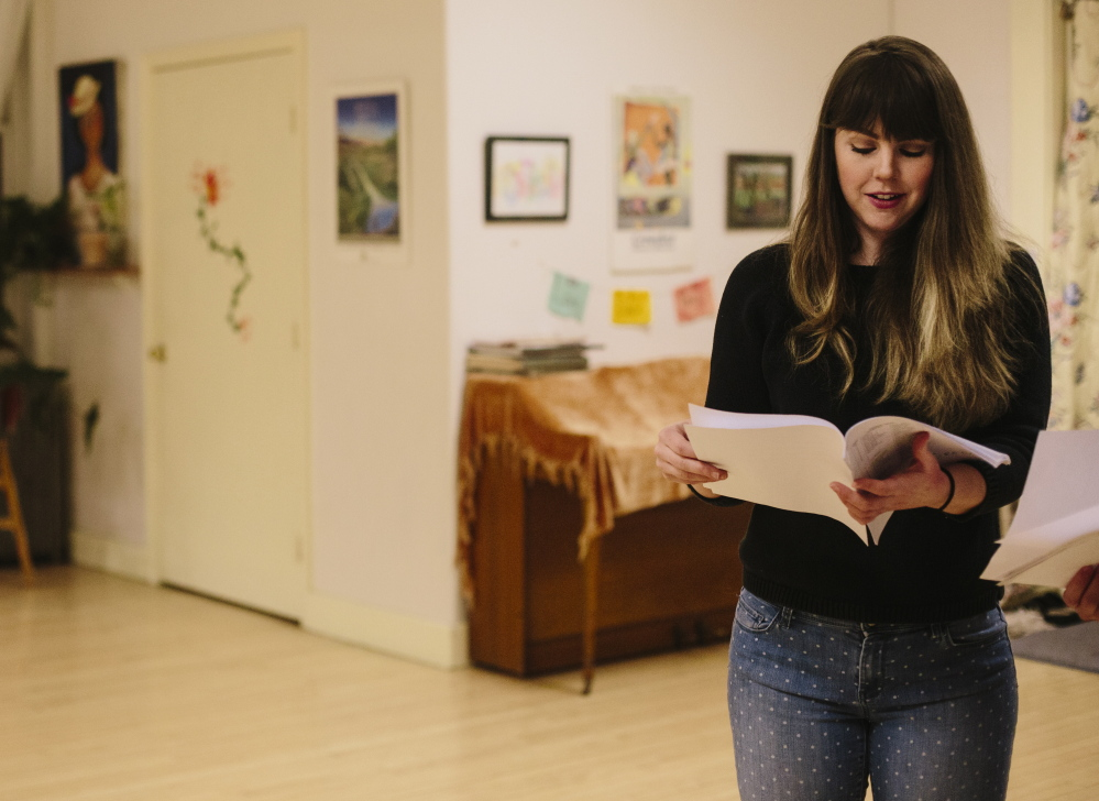 """Kacy Woodworth looks over her lines before rehearsing her part in """"The Maine Dish: A Feast of Plays About Food,"""" which will be performed March 5-8 at the Portland Ballet Studio Theater."""