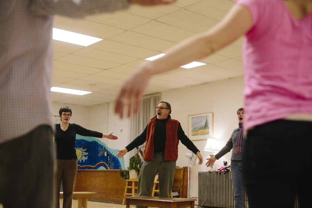 """Director Al D'Andrea of Snowlion Repertory Company leads actors in a voice warmup exercise before a rehearsal last week. The 17 actors in """"The Maine Dish"""" production play several roles in a dozen short plays."""