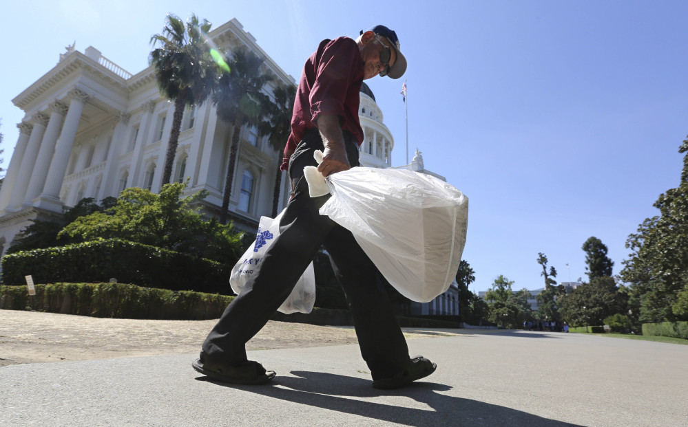 Plastic bags would be phased out of many California stores under a new state law, but a trade group has garnered enough support for referendum to block the move.
