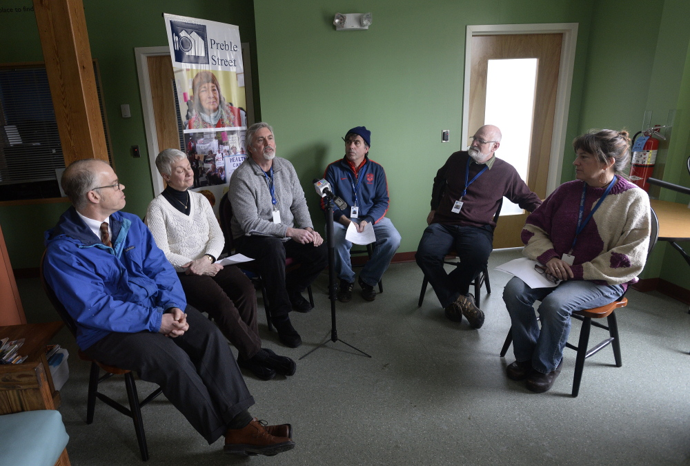 Preble Street Executive Director Mark Swann, third from left, speaks at a news conference Tuesday at a Portland teen center, accompanied by other social service agency officials. Swann said that the state is oversimplifying the homelessness issue, and that untreated mental illness and substance abuse are often the root causes.
