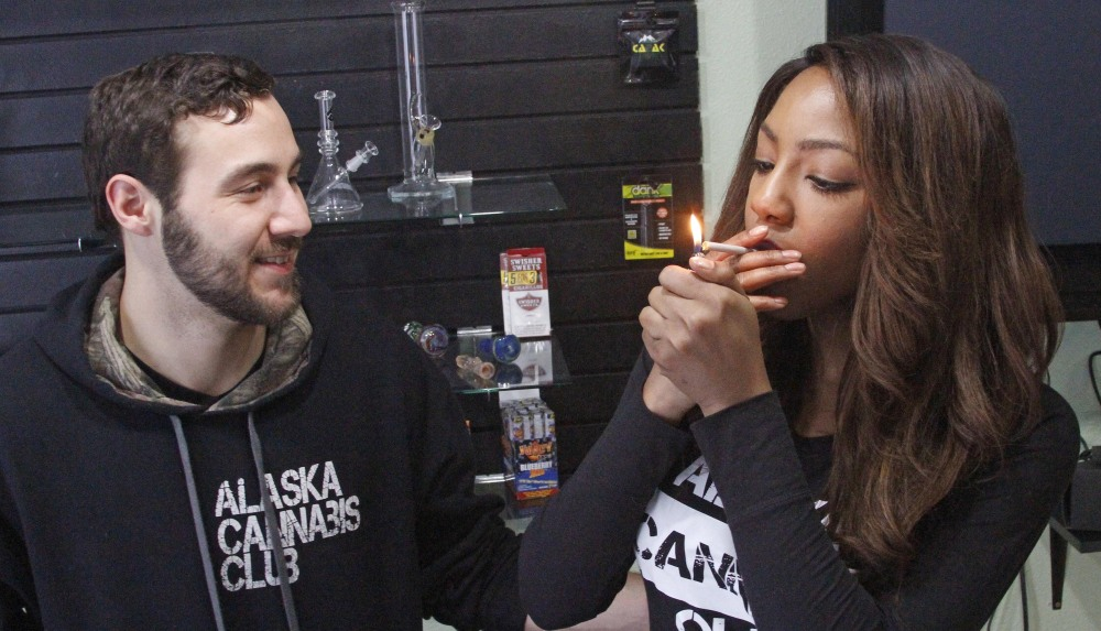 Alaska Cannabis Club co-founder Peter Lomonaco shares a joint with CEO Charlo Greene at their medical marijuana dispensary Tuesday in Anchorage.