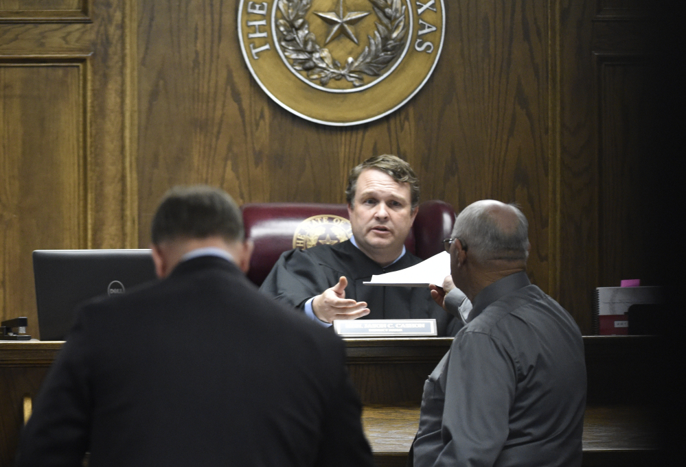 State District Judge Jason Cashon receives the verdict of guilty Tuesday night from the jury in the capital murder trial of former Marine Cpl. Eddie Ray Routh.