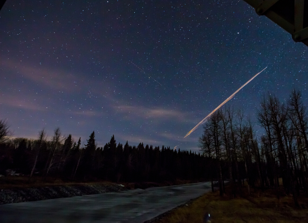 Canadian photographer Neil Zeller's 10-second time exposure photo shows a streak of light from a Chinese rocket burning up upon re-entry in the atmosphere.