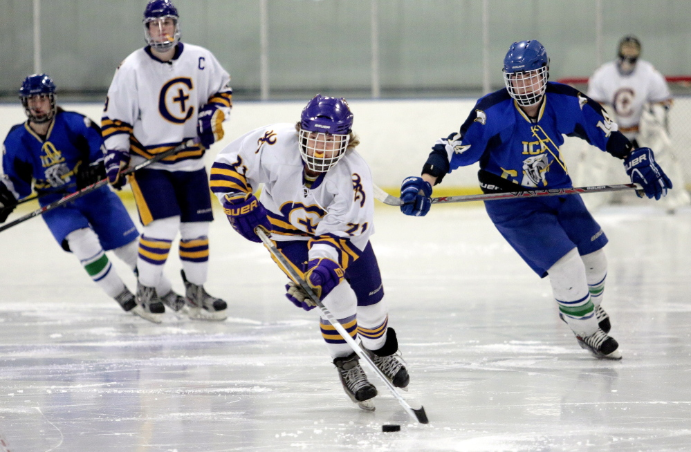 Luke Trickey of Cheverus has plenty of room to skate with the puck as did the rest of his teammates in a 12-1 quarterfinal win.