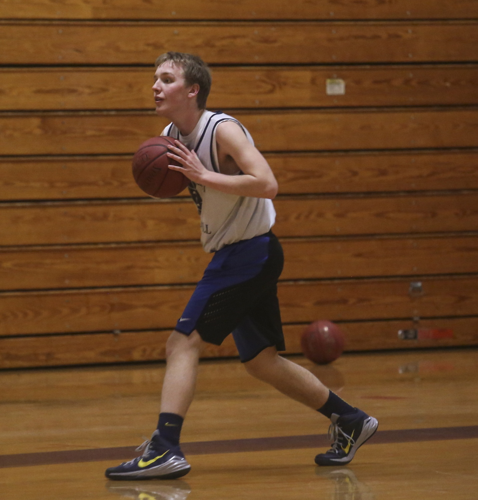 Medomak Valley High School captain Nicholas DePatsy does a passing drill during practice at Medomak Valley High School in Waldoboro on Tuesday.