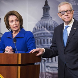 Senate Minority Leader Harry Reid, right, and House Democratic Leader Nancy Pelosi discuss funding for the Department of Homeland Security in Washington on Thursday. Reid declined to say whether he would try to block a short-term, stopgap bill if the House passed one. Pelosi argued that a short-term bill is not an ideal solution.