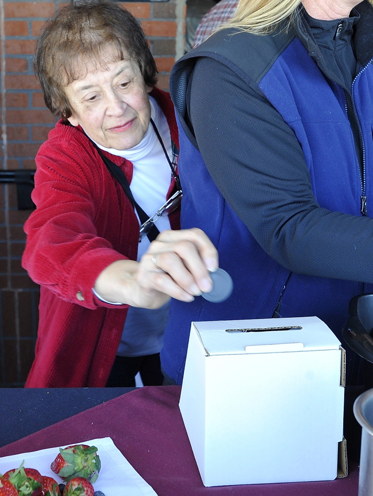 Martha Donahue of Portland casts her vote at the Incredible Breakfast Cook-Off held at the Sea Dog Brewing Company in South Portland on Friday.