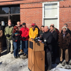 Portland Mayor Michael Brennan speaks Friday outside the city's Oxford Street Homeless Shelter during a news conference at which he defended the city's General Assistance program following an audit by the Maine Department of Health and Human Services.