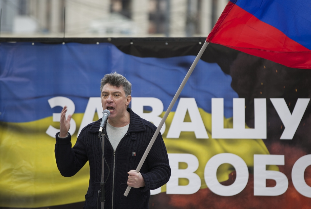 Boris Nemtsov, seen addressing demonstrators during a massive rally to oppose president Vladimir Putin's policies in Ukraine, was shot and killed in Moscow early Saturday. 2014 Associated Press file photo