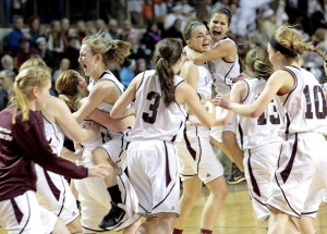 Greely celebrates after beating Presque Isle 56-39 to win the Class B girls' basketball state title on Friday at Cross Insurance Arena in Portland. Gabe Souza/Staff photographer