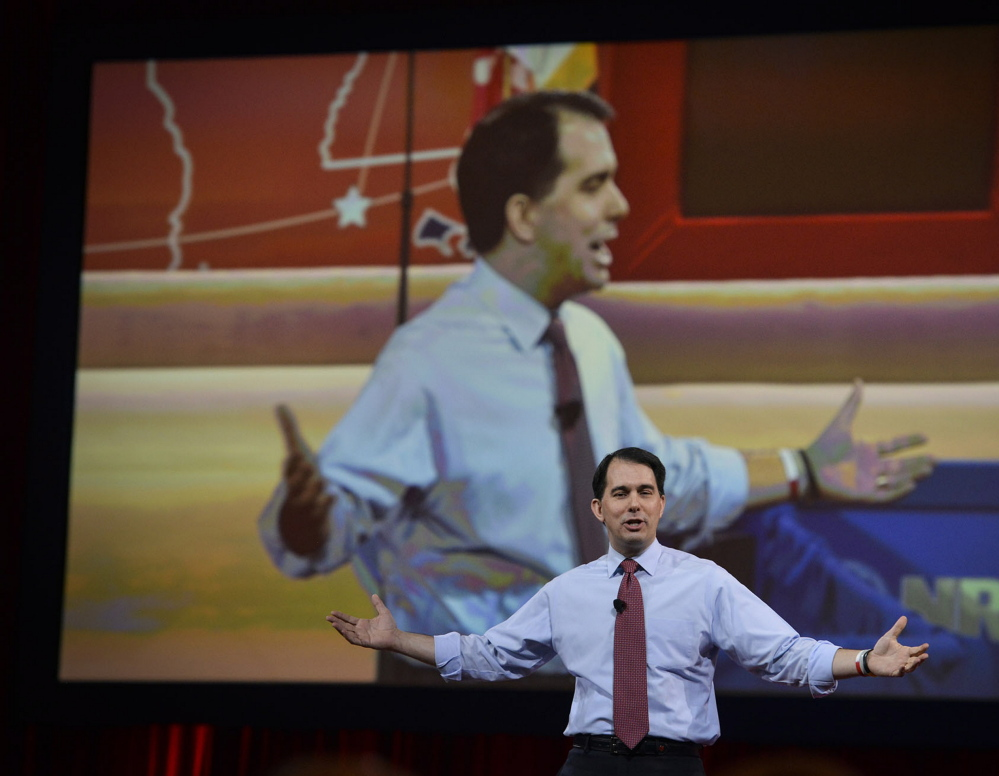 """""""If I can take on 100,000 protesters,"""" Wisconsin Gov. Scott Walker told CPAC attendees, referring to his confrontation with labor unions, """"I can do the same across the world."""""""