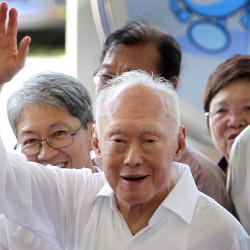 Singapore's Minister Mentor Lee Kuan Yew waves to supporters as he arrives at an elections nomination center in Singapore in April 2011. Singapore's government says the condition of Lee, the country's 91-year-old founding father, has improved slightly as he remains on life support in intensive care, where he is being treated for severe pneumonia.