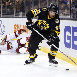 Boston's Brad Marchand skates away from Arizona's Keith Yandle during the second period of the Bruins' 4-1 win Saturday in Boston. Marchand had a goal and the Bruins have won three of four after losing six straight.