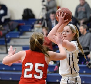 Yarmouth's Alison Clark looks for an open teammate as Skye Conley of Gray-New Gloucester plays defense on Feb. 3. Gray-New Gloucester beat Yarmouth 43-27.