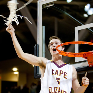FEB. 27 FINALS: Ethan Murphy, the senior captain who hit the game-winning layup as time expired to give Cape Elizabeth a 42-40 victory over Medomak Valley, celebrates after cutting down a net.