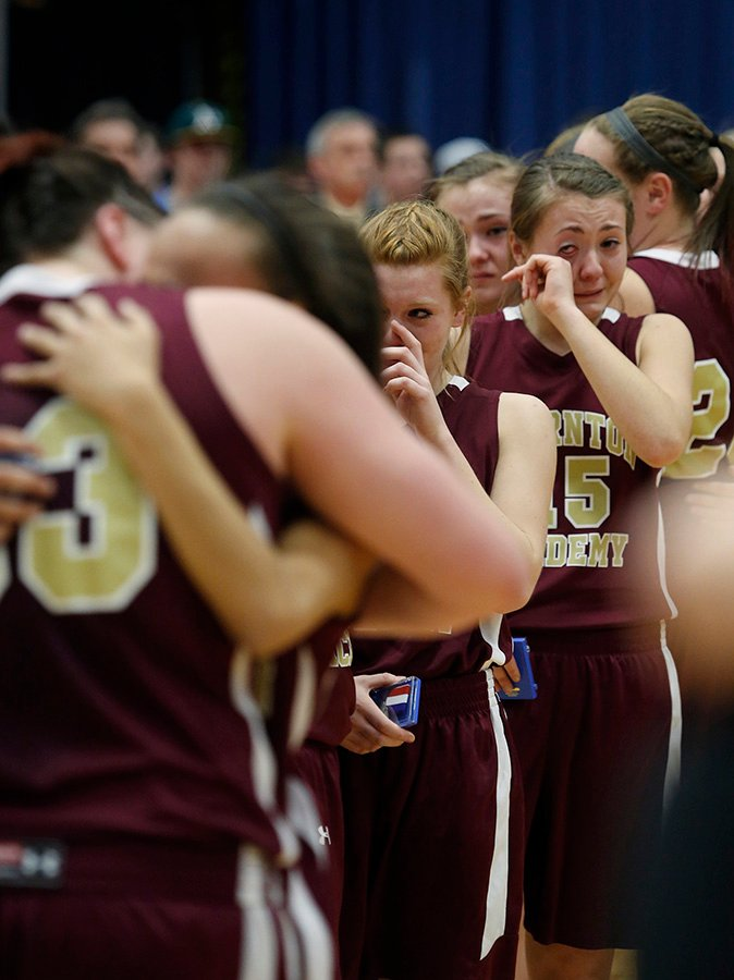 Thornton Academy basketball players console eachother after losing to Lawrence in the Class A State Championship game. Derek Davis/Staff Photographer