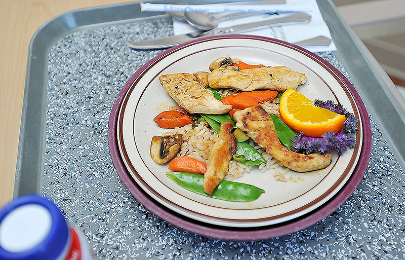 Healthier and locally sourced food, like this stir-fry with locally grown carrots, is served to patients at the Maine General Medical Center.