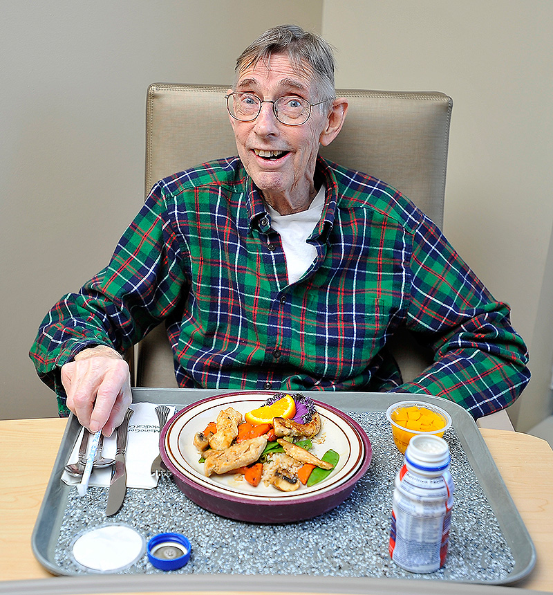 Hallowell resident and patient Paul Burd is happy to get a healthy chicken stir-fry at the Maine General Medical Center.