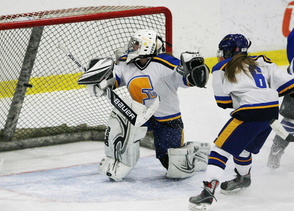 Falmouth High's goalie Ally Hurdman watches as a puck slips through during the first period of the State Championship game Saturday. Joel Page/Staff Photographer