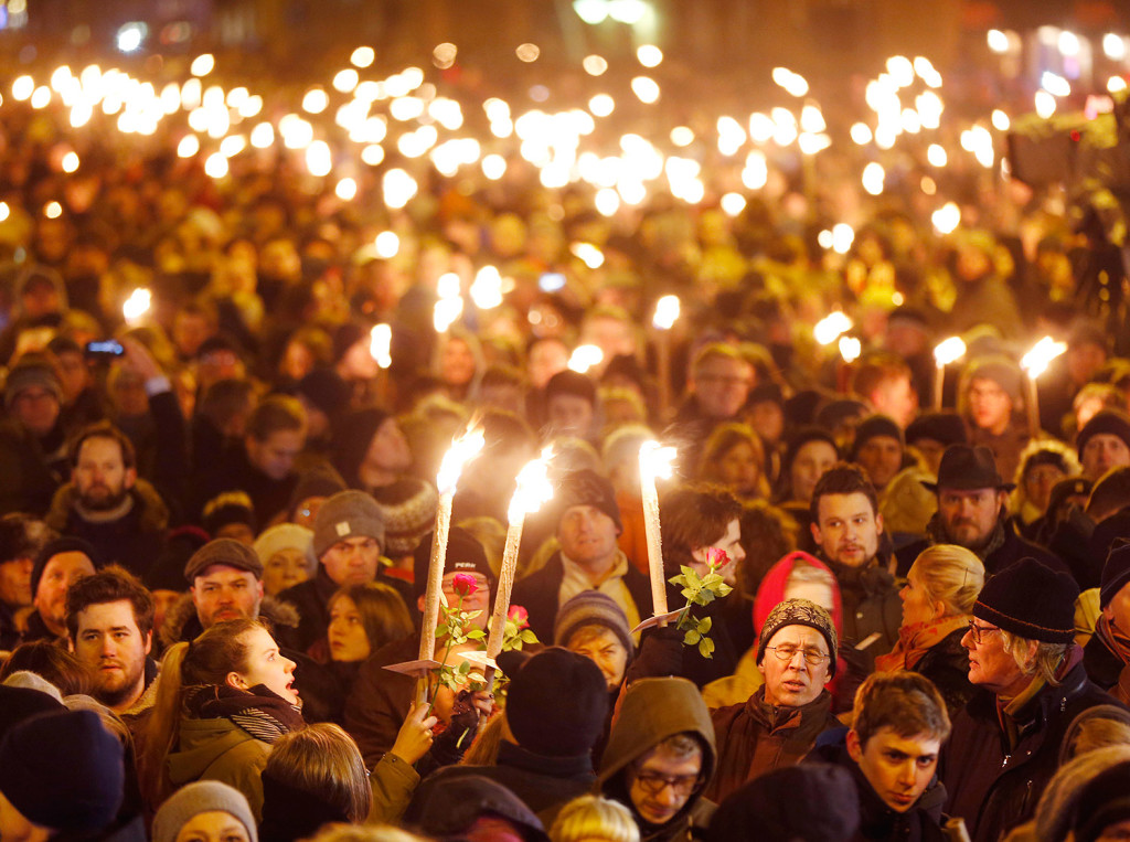 Hundreds of people gather for a vigil near the cultural club in Copenhagen, Denmark. The slain gunman behind two deadly shooting attacks in Copenhagen was released from jail just two weeks ago and might have become radicalized there last summer, a source close to the Danish terror investigation told The Associated Press on Monday. The prime ministers of Denmark and Sweden were expected to join thousands of people at memorials in Copenhagen on Monday evening.