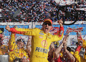 Joey Logano celebrates in Victory Lane after winning the Daytona 500 NASCAR Sprint Cup series auto race at Daytona International Speedway, Sunday. The Associated Press