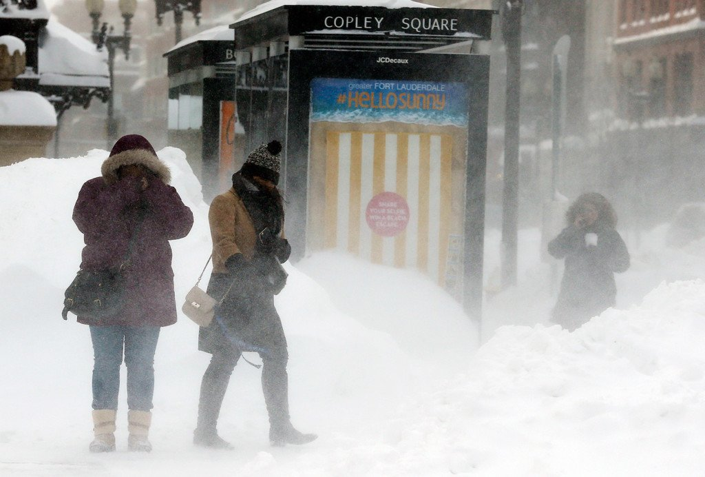 Pedestrians brace against blowing snow in Copley Square in Boston Sunday. A storm brought a new round of wind-whipped snow to New England on Sunday, threatening white-out conditions in coastal areas and forcing people to contend with a fourth winter onslaught in less than a month.