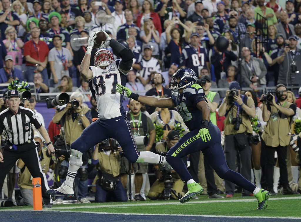 New England Patriots tight end Rob Gronkowski (87) catches a 22-yard touchdown pass against Seattle Seahawks outside linebacker K.J. Wright (50) during the first half of NFL Super Bowl XLIX football game Sunday. The Associated Press