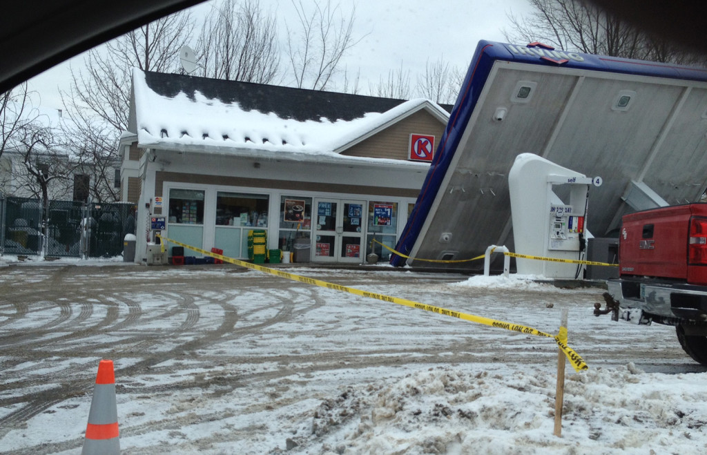 The awning at the Irving gas station in downtown Conway, N.H., collapsed Thursday morning as workers were shoveling off snow.