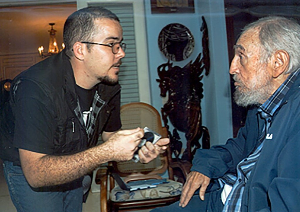 Cuba's website Cubadebate displays a photo of Fidel Castro talking with the head of the main Cuban student union Randy Perdomo Garcia in Havana Tuesday. The Associated Press