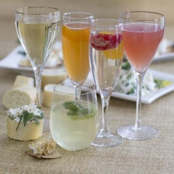 Sparkling wine cocktails, from left: Rhubarb, honey bourbon, crushed, ruby and mojiito.