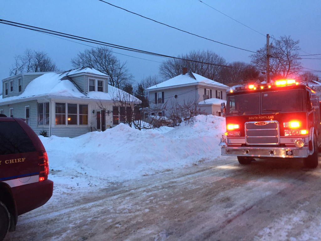 Firefighters at the scene of a fire at 61 Ocean View Ave. in South Portland. Ray Routhier/Staff Writer