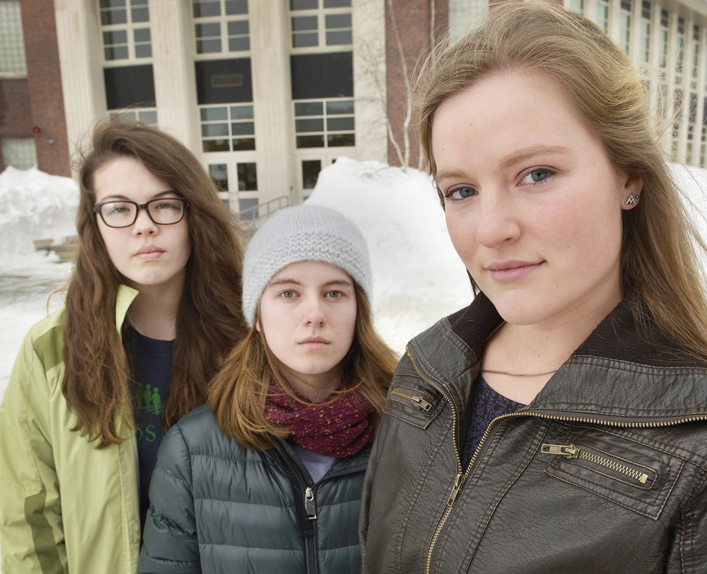 South Portland senior class president Lily SanGiovanni, joined by Morrigan Turner, left, and Gaby Ferrell, has led a subtle effort to let students and teachers know they don't have to join in reciting the Pledge of Allegiance each morning.