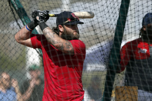"Red Sox first baseman Mike Napoli takes batting practice on Monday. Napoli had a painful off-season in which he underwent complex surgery for a severe case of obstructive sleep apnea.  He spent six weeks on a liquid diet as he recovered from the operation. The outcome? ""It's been night and day,"" he says. ""Just my energy level. When I wake up and when I get out of bed and get my day started. Before I used to be in bed until like one o'clock. It's just different."""
