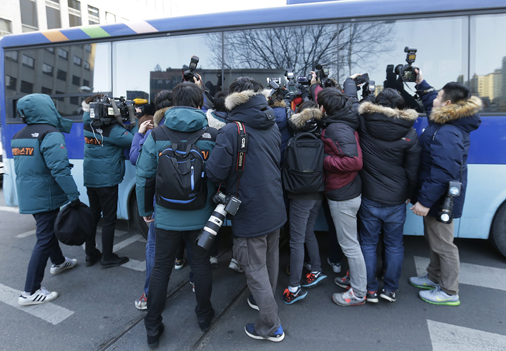 Members of the media try to get pictures of Cho Hyun-ah, the former vice president of Korean Air Lines, outside of the Seoul Western District Court after her trial in Seoul Thursday. The Associated Press