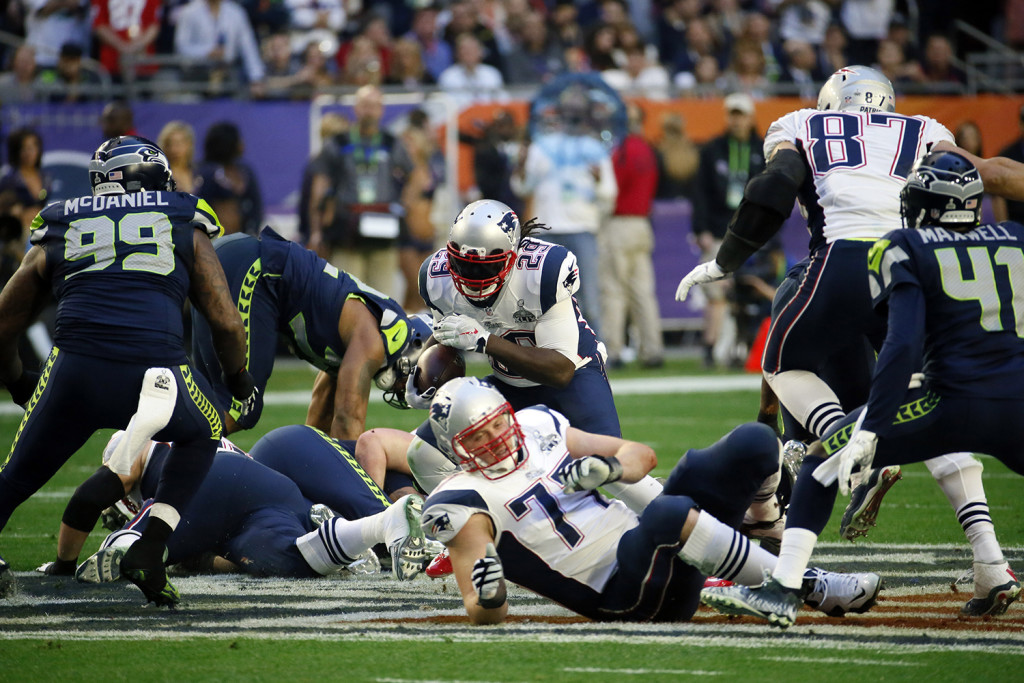 New England Patriots running back LeGarrette Blount (29) runs the ball against the Seattle Seahawks during the first half of NFL Super Bowl XLIX football game Sunday. The Associated Press
