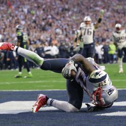 New England Patriots wide receiver Brandon LaFell (19) scores on an 11-yard touchdown pass during the first half of NFL Super Bowl XLIX football game against the Seattle Seahawks on Sunday. The Associated Press