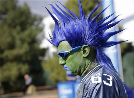 A Seattle Seahawks fan makes his way to University of Phoenix Stadium before Sunday's Super Bowl. The Associated Press