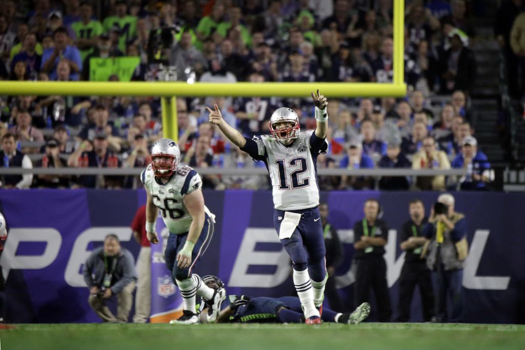 New England Patriots quarterback Tom Brady (12) celebrates a 4-yard touchdown against the Seattle Seahawks during the second half of NFL Super Bowl XLIX football game Sunday. The Associated Press