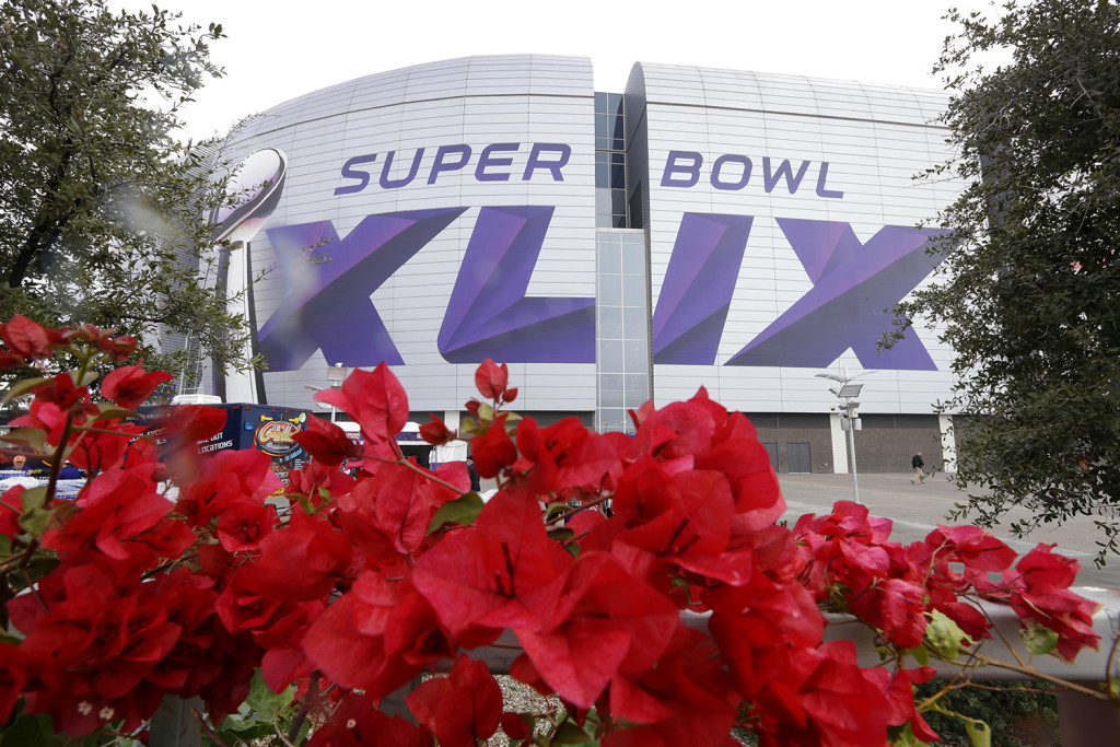 Flowers blossom outside University of Phoenix Stadium before the NFL Super Bowl XLIX football game between the Seattle Seahawks and the New England Patriots Sunday. The Associated Press