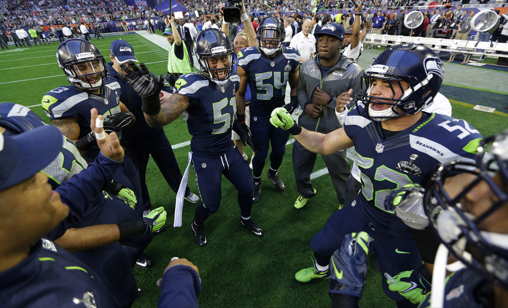 Seattle Seahawks players get fired up on the field before the NFL Super Bowl XLIX football game against the New England Patriots Sunday. The Associated Press