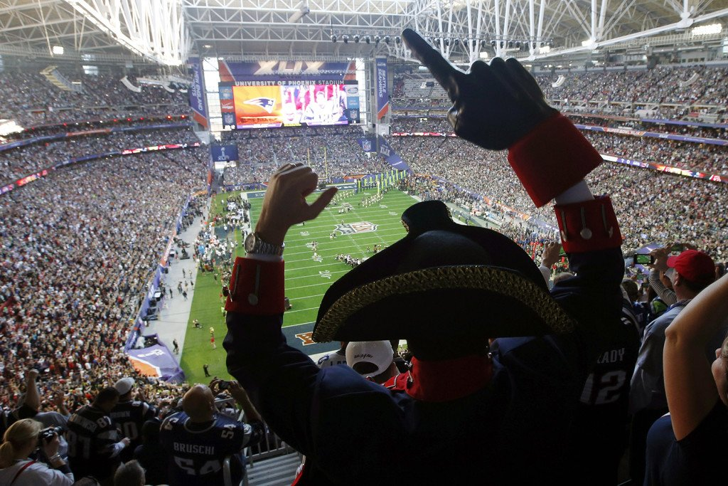 A New England Patriots fan cheers before the NFL Super Bowl XLIX football game between the Patriots and the Seattle Seahawks  Sunday. The Associated Press
