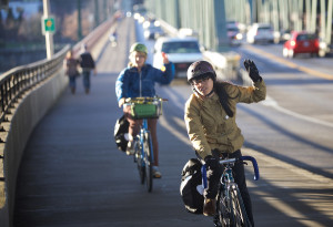 Pedestrians and cyclists nearly outnumbered the cars on the Hawthorne Bridge on Feb. 17 as unseasonably high temperatures and sun made February in Portland, Ore. feel like spring.