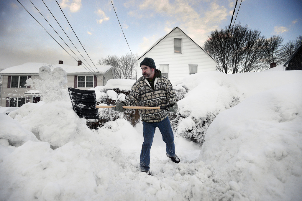 Sean Gallagher shovels a path in front of his High Street home in Saco on Thursday morning.