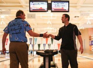 Terrence Robinson of Gray shakes PBA player Walter Ray Williams Jr.'s hand after winning against the pro during the PBA Xtra Frame Maine Shootout at Bayside Bowl in Portland on Monday.