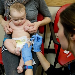 Bethany Hickey holds her 6 month old son, Alexander while he receives a Prevnar Pneumococcal Meningitis vaccine from clinical assistant Laura Boyer at Intermed Pediatric Care in South Portland on Feb. 5, 2015.
